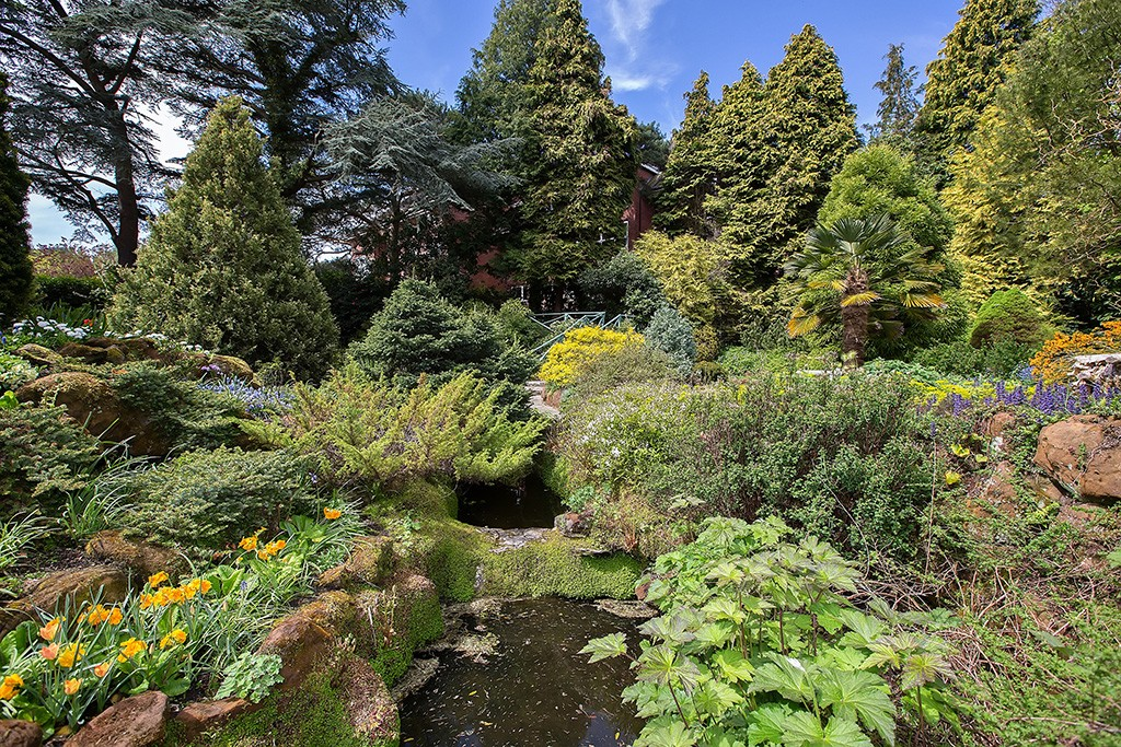 This Outstanding Example Of The Arts And Crafts Style Of Landscape Design  Uses A Combination Of Rock Work And Water To Create A Realistic Landform  Giving ...